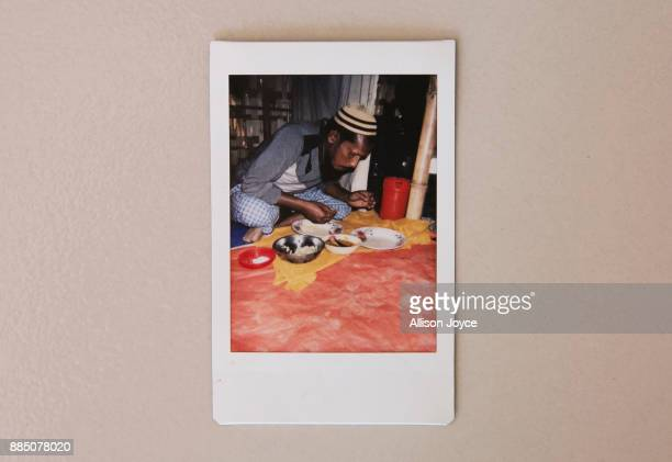 COX'S BAZAR BANGLADESH DECEMBER 03 A photo taken by 16 year old Farmina Begum of her father eating breakfast in a refugee camp is seen December 3...