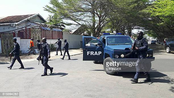 A photo taken by a witness at the scene shows Ivorian security forces gathered in front of a hotel in the beach resort of GrandBassam after heavily...