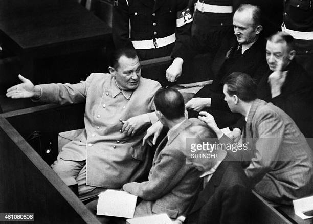 A photo taken during 1946 at the Nuremberg International Military Tribunal court shows former President of the Reichstag Hermann Goering speaking...