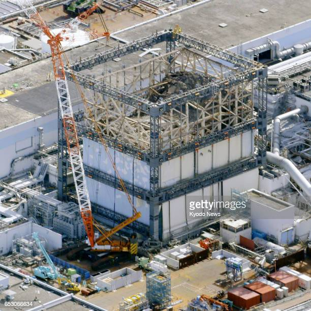 Photo taken Feb 25 from a Kyodo News helicopter shows the No 1 reactor of the Fukushima Daiichi nuclear plant which suffered a meltdown following the...