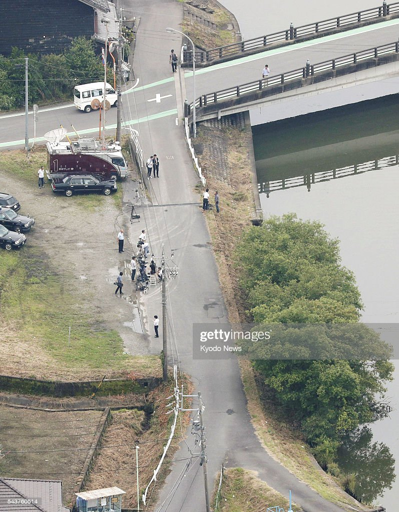 Photo taken from a Kyodo News helicopter shows the scene where seven pupils were injured after a car drove into a group of children walking to school in Kaizu in the central Japan prefecture of Gifu on June 30, 2016. Police detained a man who was found in a damaged vehicle in a parking lot approximately 100 meters from the site, on suspicion of his involvement in the hit-and-run.