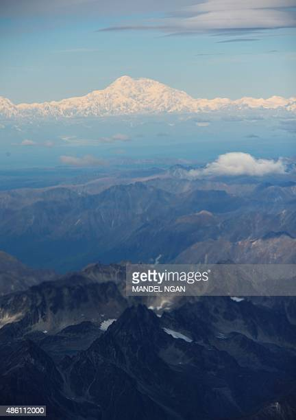 A photo taken from Air Force One shows Denali which was formerly known as Mount McKinley on August 31 2015 US President Barack is to announce the...