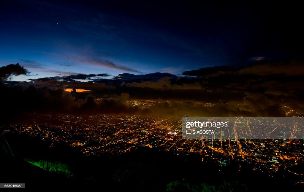 Photo taken from Guadalupe Mountain of Bogota City, during a sunset on December 19, 2011. AFP PHOTO / Luis Acosta /