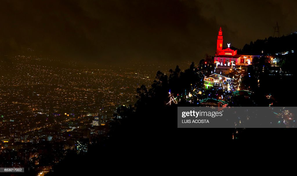 Photo taken from Guadalupe Mountain of the sanctuary Basilica of the Fallen Lord of Montserrate, decorated with Christmas lights, at the Monserrate hill, in Bogota on December 19, 2011. AFP PHOTO/Luis Acosta /