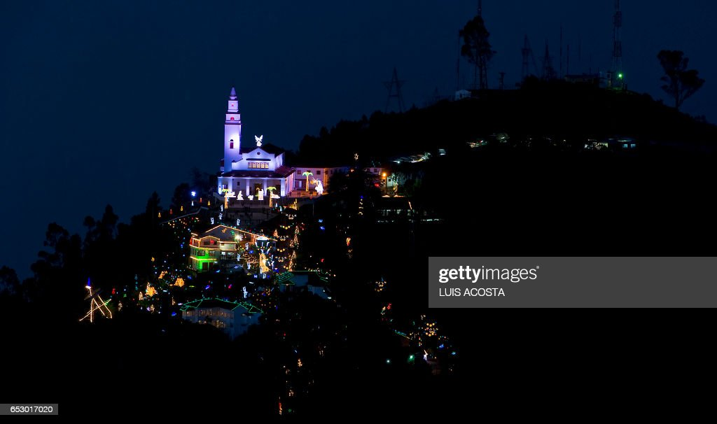 Photo taken from Guadalupe Mountain of the sanctuary Basilica of the Fallen Lord of Montserrate, decorated with Christmas lights, at the Monserrate hill, in Bogota on December 19, 2011. AFP PHOTO / Luis Acosta /