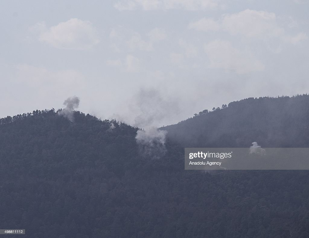 Photo taken from the Hatay province of Turkey shows that smoke rises as the Russia and Syrian regime forces attack the Turkmen region near Turkeys border in Lattakia, Syria on November 26, 2015.