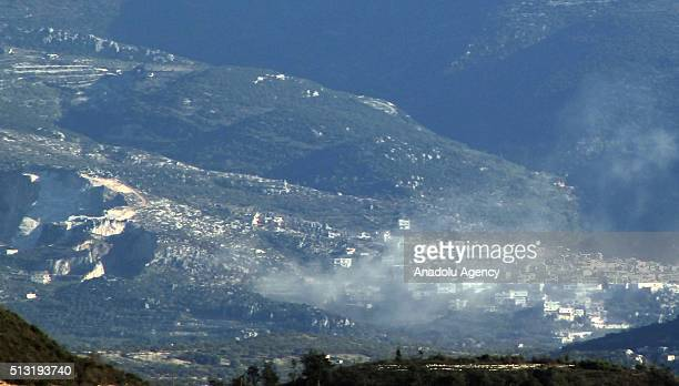 Photo taken from the Hatay province of Turkey shows that smoke rises after Syrian regime forces attacked villages at Jabal alAkrad province in...