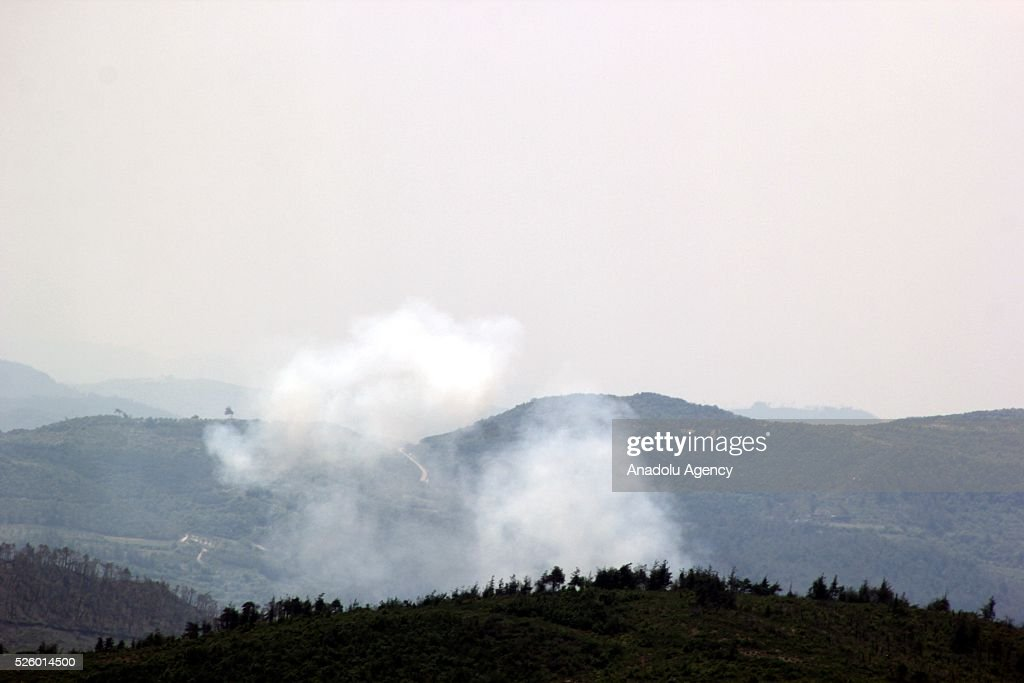 Photo taken from Yayladagi district of Turkey's Hatay province shows rising smoke as the Assad forces continue pounding Sallur, Zeytincik, Kelez, Sarraf, and Karaman villages at Turkmen Mountain, in Latakia, Syria on April 29, 2016.