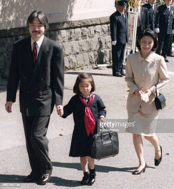 Photo taken in April 1998 shows Princess Mako heading to an entrance ceremony for the Gakushuin Primary School in Tokyo with her parents Prince...