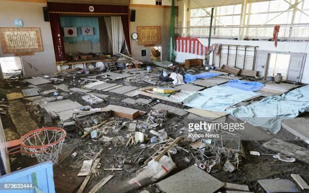 Photo taken in April 2011 shows the gymnasium of cityrun Nobiru Elementary School in Higashimatsushima Miyagi Prefecture just weeks after a...