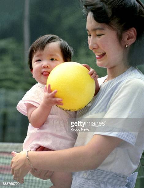 Photo taken in August 1992 shows a 9monthold Princess Mako being held by her mother Princess Kiko in Karuizawa Nagano Prefecture The 25yearold...