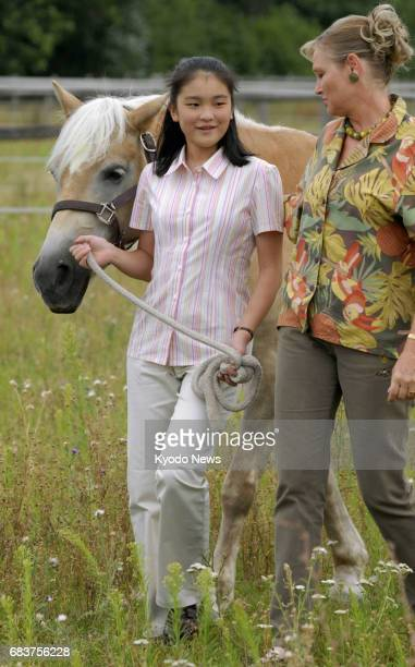 Photo taken in August 2006 shows Japan's Princess Mako strolling while pulling the reins on a horse on a ranch near Vienna where she was staying on a...