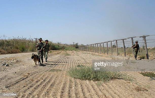 A photo taken in August 2010 made available on September 21 shows Tajik border guards patrolling the TajikAfghan border somewhere in an undisclosed...