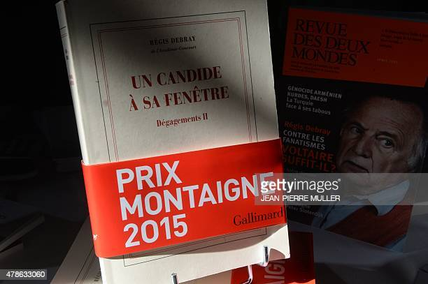 A photo taken in Bordeaux on June 26 2015 shows French philosopher and writer Regis Debray's book 'Un Candide a sa Fenetre' after it was awarded the...