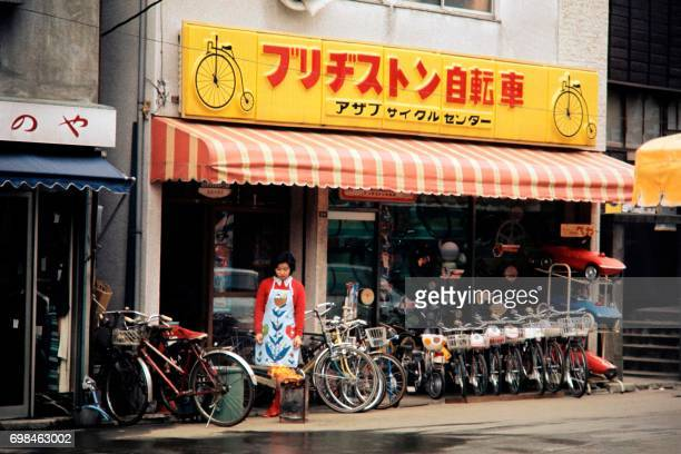 Photo taken in February 1972 shows a bicycle shop in a street of Tokyo / AFP PHOTO /