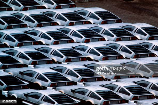 Photo taken in February 1982 in Dunmurry South Western of Belfast shows stockpiled Delorean cars at the Delorean Motor plant bafore being exported to...
