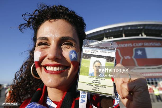 Photo taken in June 2017 shows a supporter of the Chile soccer team showing off her 'FAN ID' a personalized visitor card to get to the Confederations...