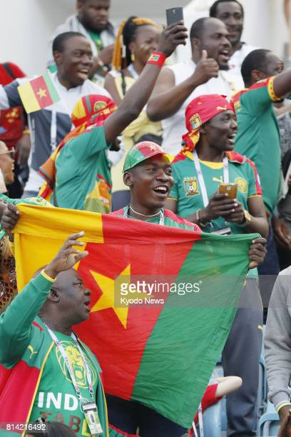 Photo taken in June 2017 shows Cameroon supporters cheering before a Confederations Cup match in Sochi Russia Russia will host the 2018 World Cup...