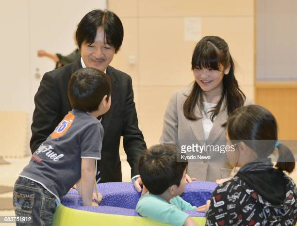 Photo taken in March 2014 shows Japan's Princess Mako a granddaughter of Emperor Akihito meeting children who lost their parents in the March 2011...