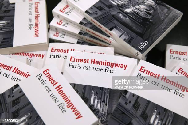 A photo taken in Paris on November 20 2015 shows copies of late US author Ernest Hemingway's novel 'Paris est une fete' US literary great Ernest...