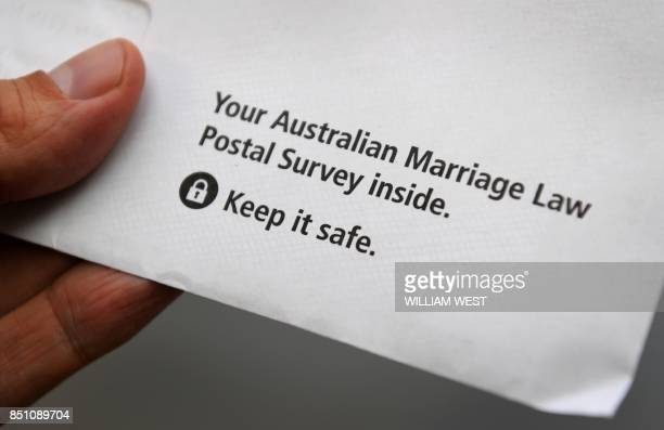 A photo taken in Sydney on September 20 shows an envelope containing the contentious postal survey on samesex marriage with ballots delivered across...
