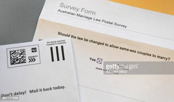 A photo taken in Sydney on September 20 shows the voting form in the contentious postal survey on samesex marriage with ballots delivered across the...