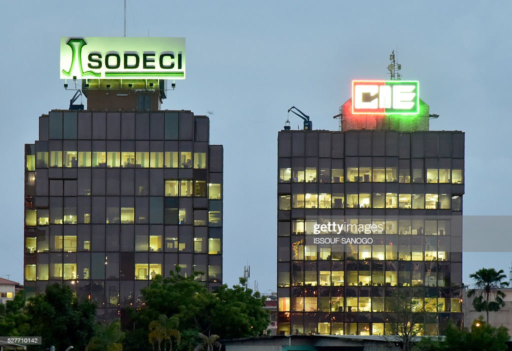 A photo taken in the Treichville suburb of Abidjan on May 3, 2016 shows the headquarters of Ivory Coast's power firm Compagnie Ivoirienne d'Elecricite (CIE) and water company Societe de Distribution d'eau de Cote d'Ivoire (SODECI). Ivory Coast wants to end the monopoly of the companies which distribute electricity and water and liberalise these key sectors in the hopes of lowering prices, President Alassane Ouattara announced on May 1. / AFP / ISSOUF
