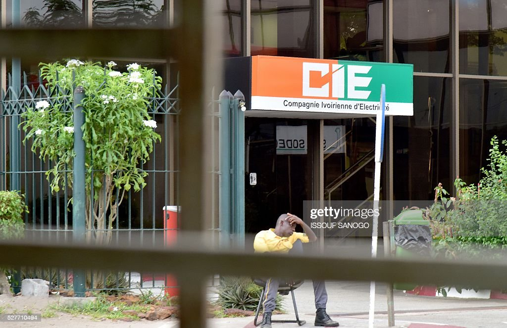 A photo taken in the Treichville suburb of Abidjan on May 3, 2016 shows the entrance to the headquarters of Ivory Coast's power firm Compagnie Ivoirienne d'Elecricite (CIE) and water company Societe de Distribution d'eau de Cote d'Ivoire (SODECI). Ivory Coast wants to end the monopoly of the companies which distribute electricity and water and liberalise these key sectors in the hopes of lowering prices, President Alassane Ouattara announced on May 1. / AFP / ISSOUF