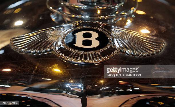 A photo taken January 2 2016 shows a view the Bentley logo on a car c during the Retromobile car show in Paris which runs from February 3 to 7 2016 /...