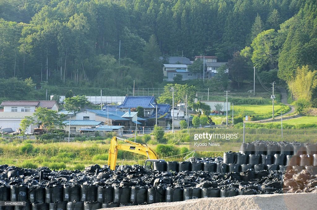 Photo taken July 1, 2016, in the northeastern Japan village of Iitate shows bags containing waste collected from radiation cleanup work there. On the day, villagers who evacuated after the Fukushima Daiichi nuclear disaster were allowed to stay at their homes overnight to prepare for the lifting of the evacuation order to be issued in March 2017.