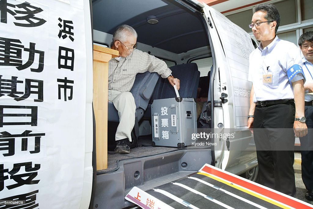 Photo taken July 1, 2016, in the western Japan city of Hamada shows a man casting an early vote for the July 10 House of Councillors election inside a van believed to be the nation's first mobile polling booth. The votemobile was introduced by the city to accommodate elderly voters who cannot easily travel to polling stations due to limited means of transportation.