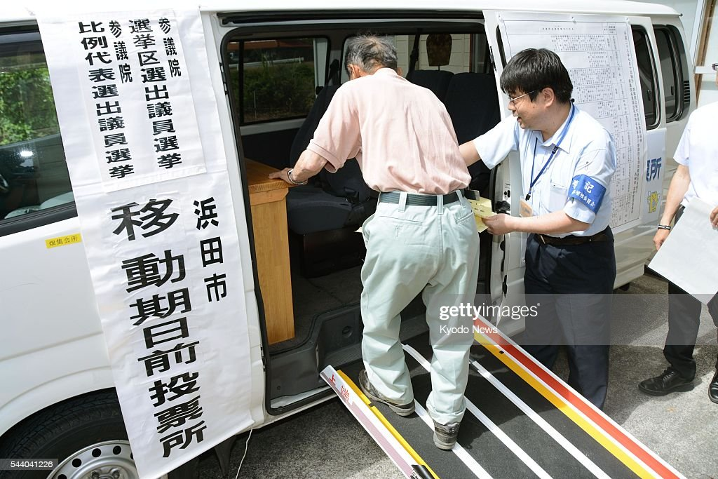Photo taken July 1, 2016, in the western Japan city of Hamada shows a person walking into a van, believed to be the nation's first mobile polling booth, to cast an early vote for the July 10 House of Councillors election. The votemobile was introduced by the city to accommodate elderly voters who cannot easily travel to polling stations due to limited means of transportation.