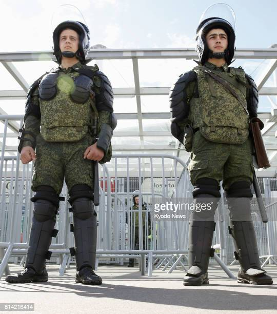 Photo taken July 2 shows heavily armed soldiers standing guard at the entrance of a soccer stadium in St Petersburg during the Confederations Cup...