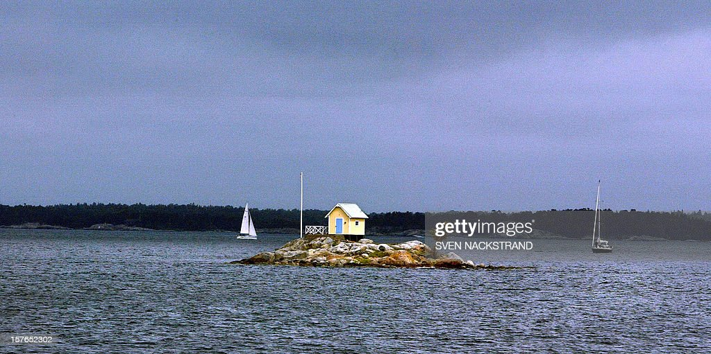 photo taken July 2003 shows one of the smallest among thousands of islets just an hour or two from downtown Stockholm where Swedes come to seek...