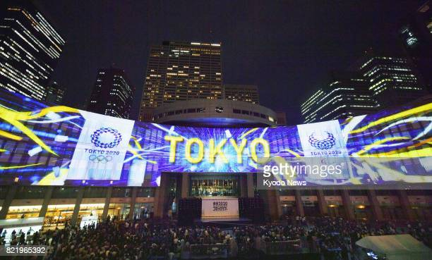 Photo taken July 24 shows projection mapping of the 2020 Tokyo Olympic and Paralympic emblems shown during an event held in front of the Tokyo...
