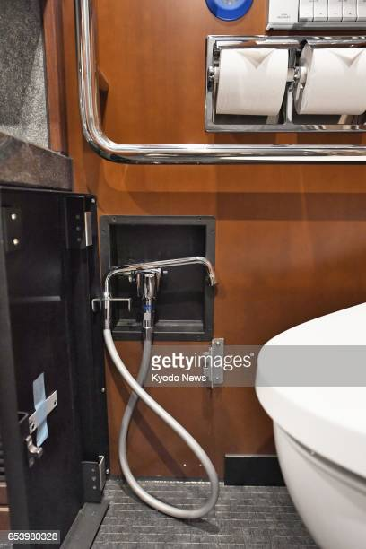 Photo taken March 16 at JR Ueno Station in Tokyo shows a toilet equipped with a nozzle for washing an artificial anus part of the barrierfree room...
