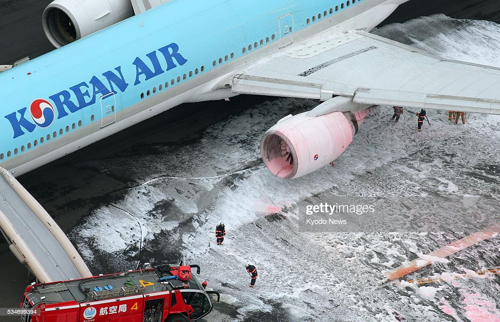 Photo taken May 27, 2016, from a Kyodo News helicopter shows the left engine of a Korean Air jet, which caught fire at Tokyo's Haneda airport. Some passengers claimed they felt ill after being evacuated, although no injuries have been reported as a result of the incident which forced the plane bound for Seoul to abort its takeoff.