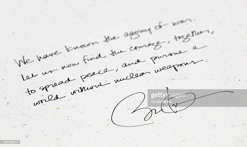 Photo taken May 27, 2016, shows an entry made by U.S. President Barack Obama that day into a guestbook at the Peace Memorial Museum, which displays various artifacts and items belonging to victims of the 1945 U.S. atomic bombing, in Hiroshima.