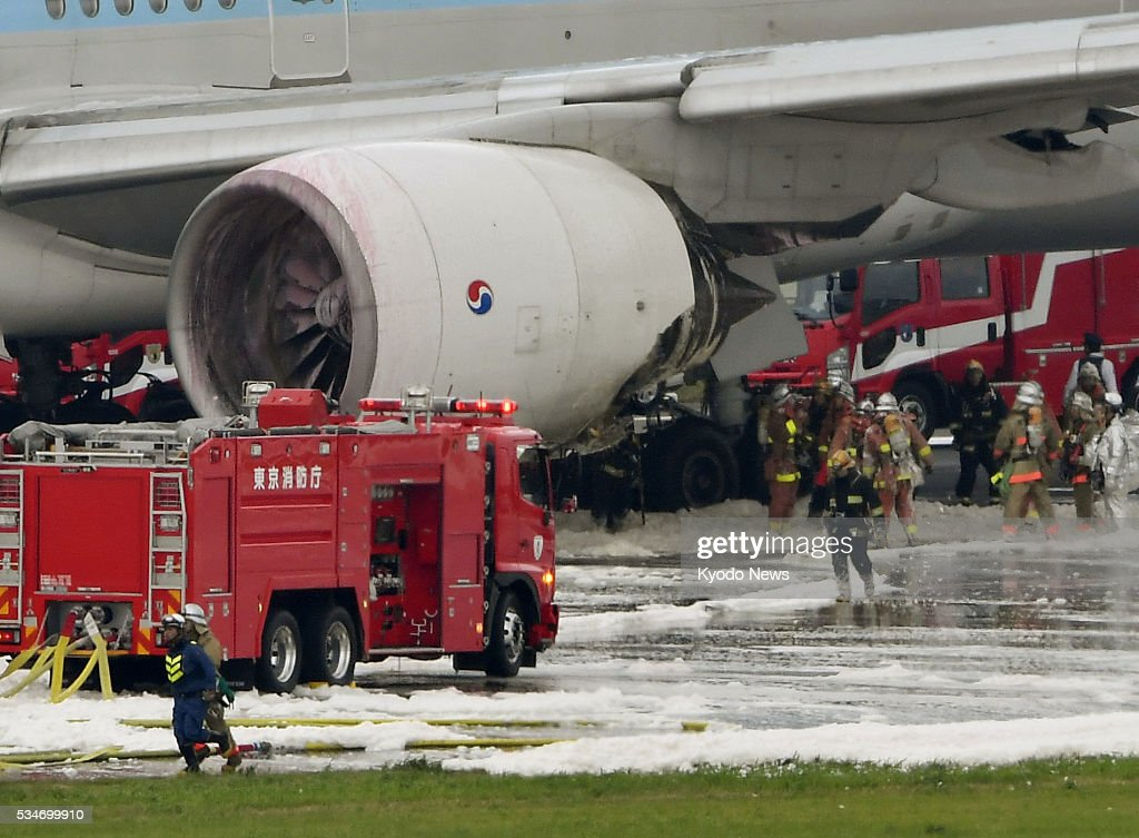 Photo taken May 27, 2016, shows the left engine of a Korean Air jet, which caught fire at Tokyo's Haneda airport. Some passengers claimed they felt ill after being evacuated, although no serious injuries have been reported as a result of the incident which forced the plane bound for Seoul to abort its takeoff.