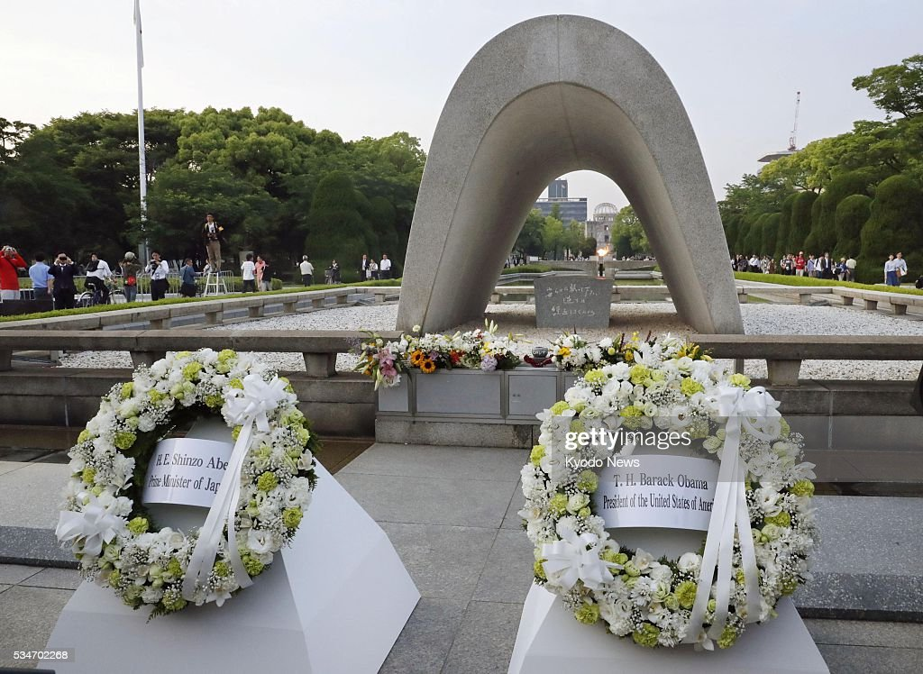 Photo taken May 27, 2016, shows wreaths laid by U.S. President Barack Obama (R) and Japanese Prime Minister Shinzo Abe, respectively, at the cenotaph for atomic bomb victims at the Peace Memorial Park in Hiroshima. Obama became the first sitting U.S. president to visit the atomic-bombed city that day.
