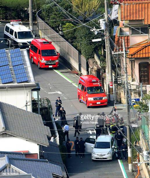 Photo taken Oct 18 from a Kyodo News helicopter shows police officers examining an accident site where five pupils and a junior high school teacher...
