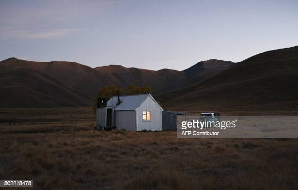 A photo taken on 21 April shows a shepherd's hut called Fat Man's Lodge in the early morning light before a flock of merino sheep are prepared to be...