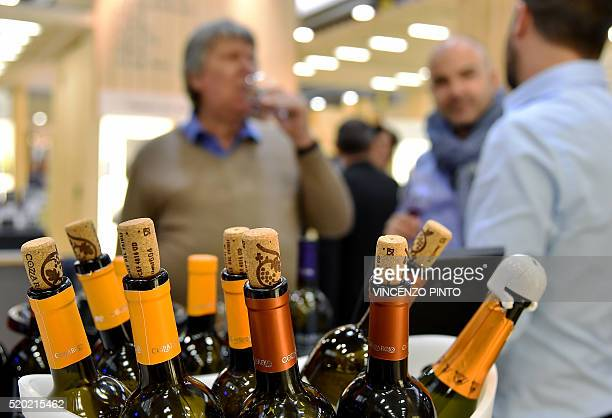 A photo taken on April 10 2016 shows bottle of wines displayed during the 50th edition of the Vinitaly wine exhibition in Verona Vinitaly is the...