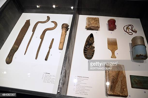 Photo taken on April 11 2014 shows items used as arms during the Rwandan genocide and objects owned by victims of the genocide displayed at The Shoah...