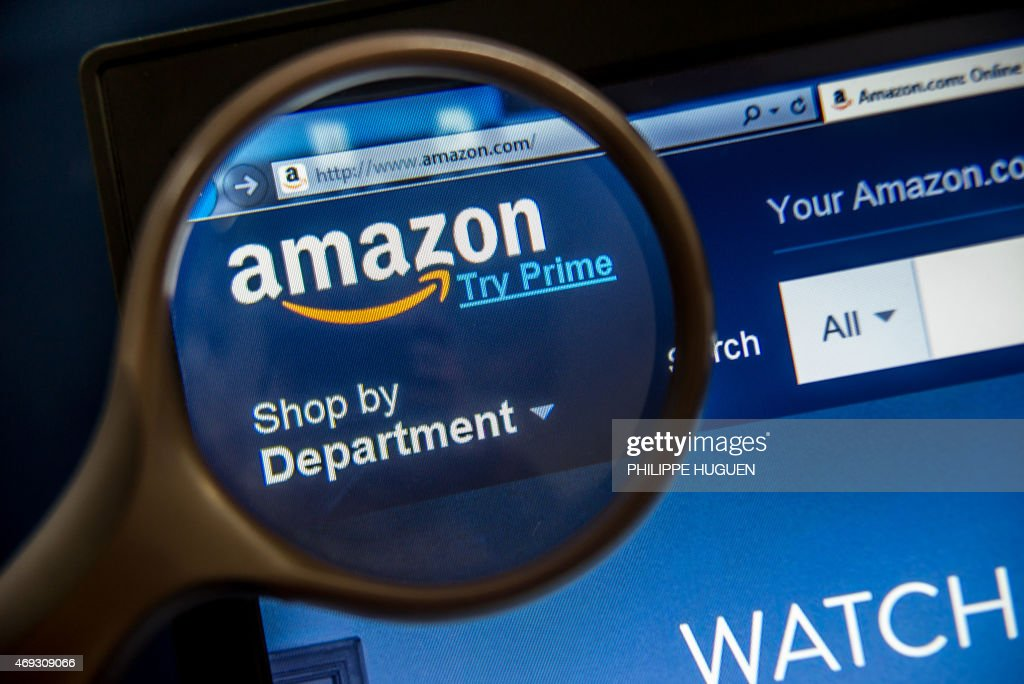 A photo taken on April 11 2015 in LauwinPlanque northern France shows a computer screen displaying the website of the Amazon electronic commerce...