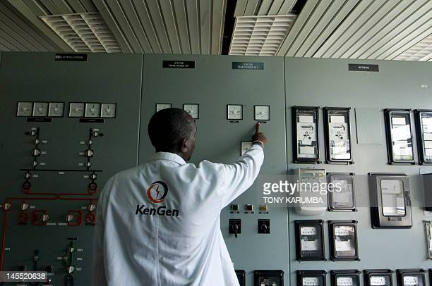 Photo taken on April 12 2012 shows an engineer with the staterun Kenya Generating Company [KENGEN] at the Masinga hydroelectricity dam control room...