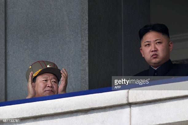 A photo taken on April 15 2012 shows a man believed to be Choe RyongHae with North Korean leader Kim JongUn attending a military parade in Pyongyang...
