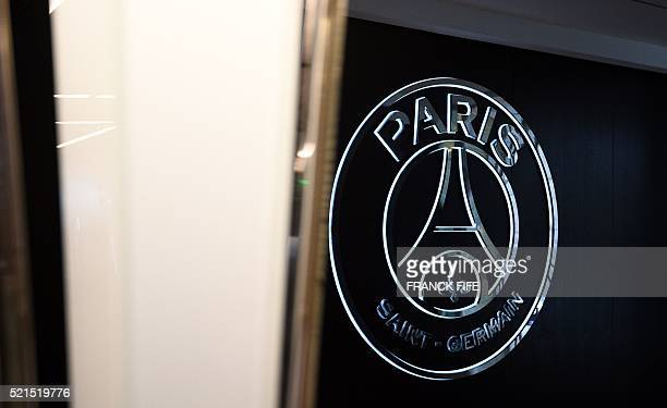 A photo taken on April 15 2016 shows the logo of French Ligue 1 football team Paris SaintGermain in the hallway leading to the lounges at Parc des...