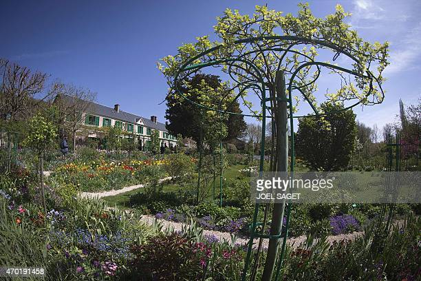 A photo taken on April 18 2015 shows the house and garden of French Impressionist artist Claude Monet in Giverny northwestern France AFP PHOTO / JOEL...