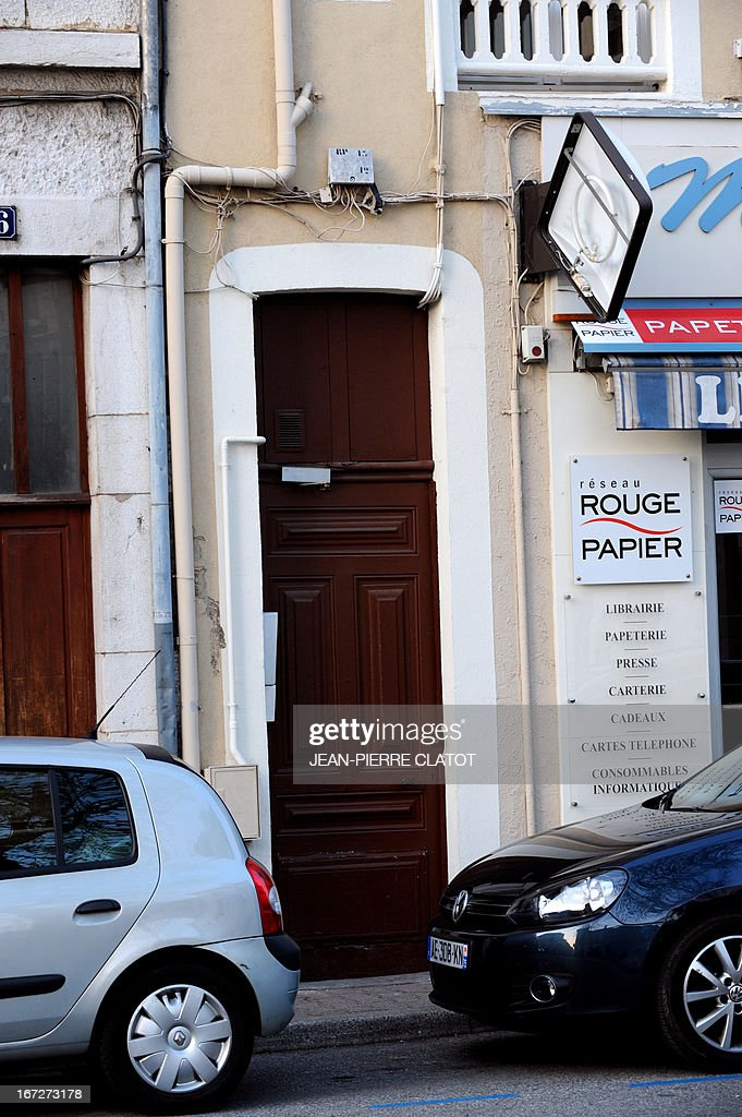 Photo taken on April 23, 2013 shows the door to a house in Moirans in which the corpse of a new-born infant was found in a freezer of an apartment. A 28 year-old woman is being questioned in Grenoble. AFP PHOTO / Jean Pierre Clatot
